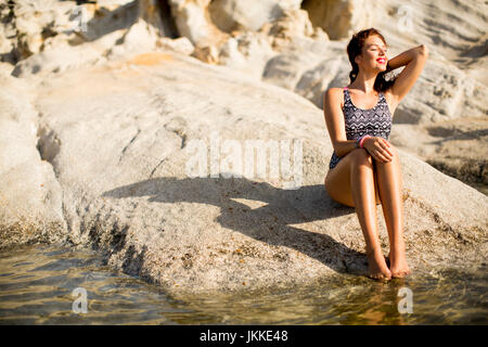 View at woman on the beach in summer - Stock Photo