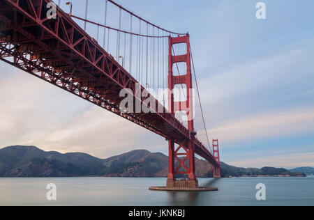 the iconic Golden Gate Bridge in San Francisco,  USA, at sunset - Stock Photo