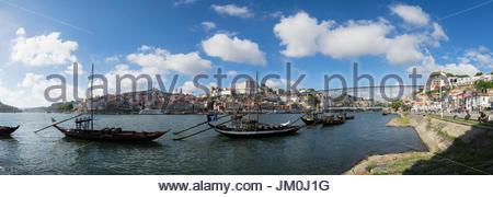 Port Wine Boats in Douro River Panoramic, Vila Nova de Gaia, Portugal - Stock Photo