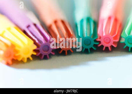 Group of colored marker pens photographed with macro lens to blur the background - Stock Photo