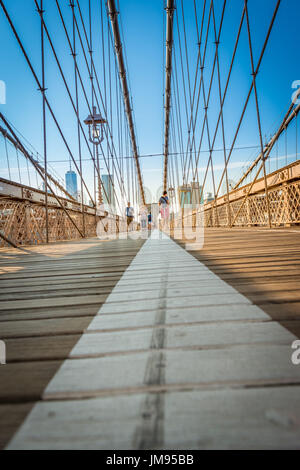 Views of Lower Manhattan and New York from the Brooklyn Bridge during summertime, New York, USA - Stock Photo