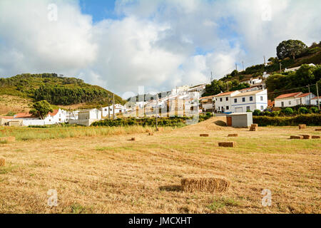 View to traditional houses in the village of Bordeira near Carrapateira, in the municipality of Aljezur in the District - Stock Photo