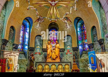 Sainte-Anne-de-Beaupre, Canada - June 2, 2017: Inside Basilica of Sainte Anne de Beaupre with statues and signs - Stock Photo