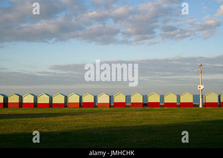 Row of beach huts in early morning sunshine, Hove, Sussex - Stock Photo