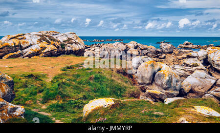 The pink granite rocks with strange shapes, coast in Brittany. The mass of enormous pink rocks, the pink granite, - Stock Photo