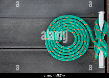 Mooring rope in spiral on a pier - Stock Photo
