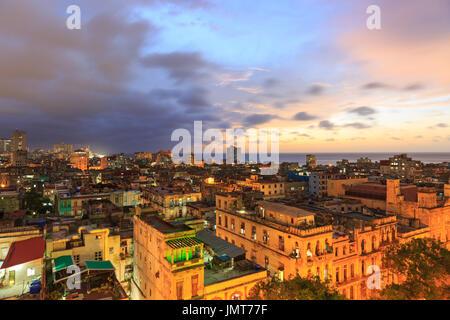 Sunset over Old Havana, La Habana Vieja from above, historic old town rooftop view at night, Havana, Cuba - Stock Photo