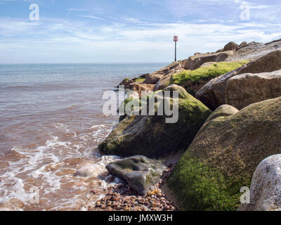 Rock armour groyne protecting the beach at Sidmouth, Devon - Stock Photo
