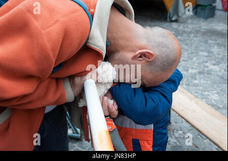 Munich, Germany -September 7th, 2015: Father and son from Syria are crying at their arrival in Munich. The refugees - Stock Photo