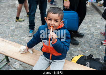 Munich, Germany -September 7th, 2015: Refugee child from Syria at Munich Central Station, Germany. He is seeking - Stock Photo
