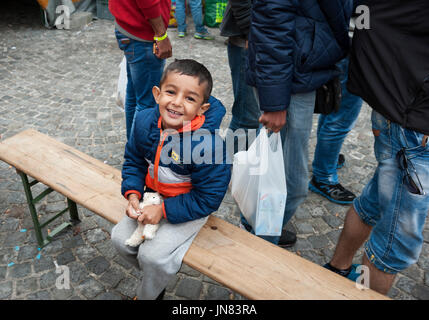 Munich, Germany -September 7th, 2015: Refugee child from Syria at Munich Central Station, Germany. The young boy - Stock Photo