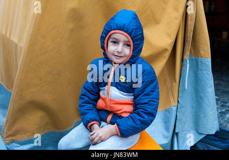 Munich, Germany -September 7th, 2015: Refugee child from Syria at Munich Central Station, Germany. Freezing and - Stock Photo