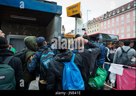Munich, Germany -September 7th, 2015: A group of refugees from Syria at the Munich Central Station. They are seeking - Stock Photo