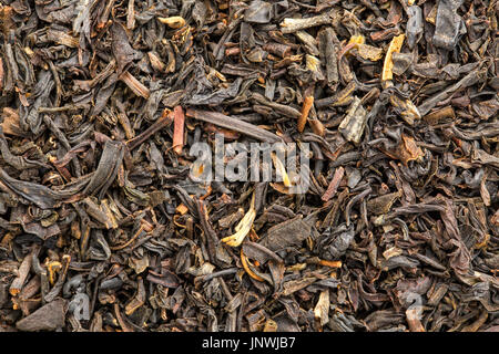 texture of Chinese oolong black tea, macro image of loose leaves - Stock Photo