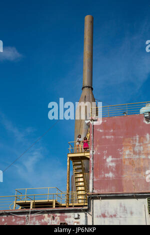 Children explore the Apung electrical generator ship, moved several kilometres inland by the 2004 tsunami in Banda - Stock Photo