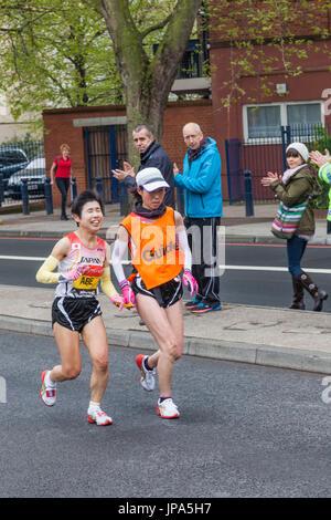 England, London, London Marathon, Sight Impaired Female Japanese Runner and Guide - Stock Photo