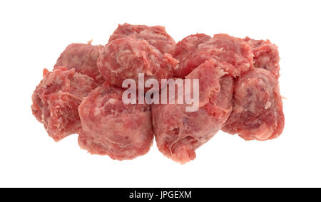 Several slices of raw mild bratwurst sausage isolated on a white background. - Stock Photo