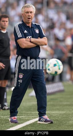 Munich, Germany. 2nd Aug, 2017. Munich manager Carlo Ancelotti follows the Audi Cup SSC Naples vs Bayern Munich - Stock Photo