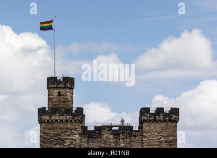 LGBT flag flying over Castle Keep at Newcastle upon Tyne - Stock Photo