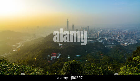 Sunset cityscape of Taipei, Taiwan as seen from a mountaintop overlooking the metropolitan city - Stock Photo