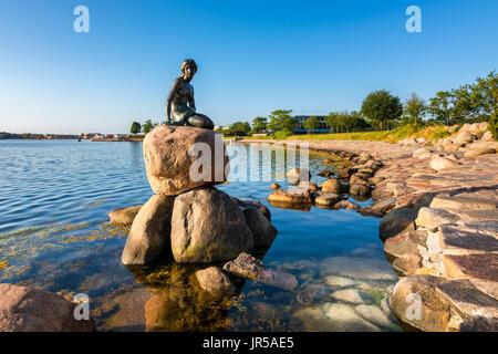 The famous Little Mermaid statue in the harbor of  Copenhagen Denmark - Stock Photo
