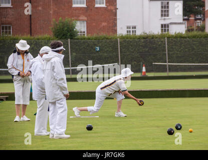 Sidmouth, Devon, UK. 4th Aug, 2017.  Rain doesn't stop play. The ladies at Sidmouth Bowls Club carry on despite - Stock Photo
