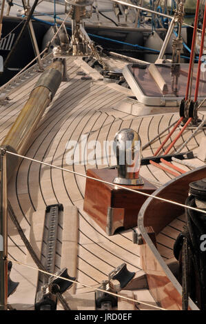 The beautifully laid and caulked wooden deck of a large traditional classic sailing yacht or boat at poles week - Stock Photo