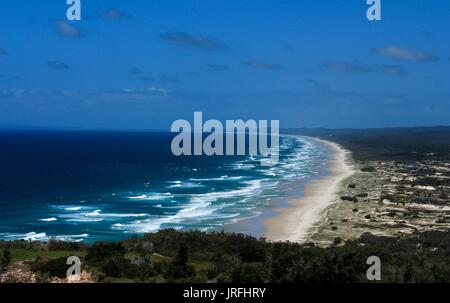 Ocean waves rolling onto sandy beach at Moreton Island, Queensland Australia - Stock Photo