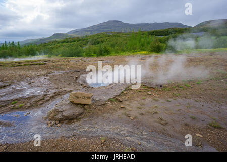 Iceland - Boiling water of little gusher at Geyser Strokkur - Stock Photo
