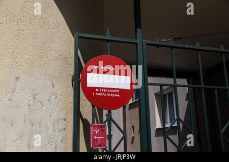 Hand-pained no entry sign on gate in Gdynia. - Stock Photo