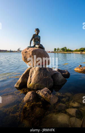 The famous Little Mermaid statue in the harbor of Copenhagen, Denmark - Stock Photo
