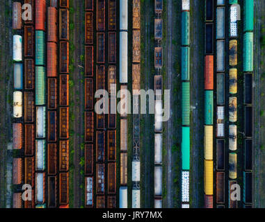 Cargo trains close-up. Aerial view of colorful freight trains on the railway station. Wagons with goods on railroad. - Stock Photo