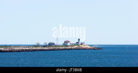 Eastern Point Light and Dog Bar Breakwater at the entrance of Gloucester Harbor, Cape Ann, Massachusetts. - Stock Photo