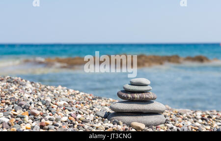 stack of zen stones on a pebble beach at crete greece - Stock Photo