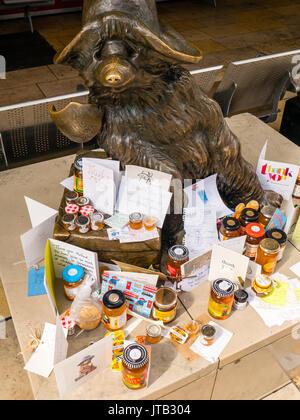 Bronze statue of Paddington Bear, by sculptor Marcus Cornish, at Paddington Station, City of Westminster, London, - Stock Photo