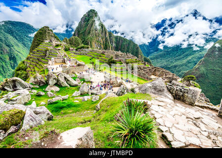 Machu Picchu in Peru with ruins of Inca Empire Huaynapicchu Mountain in Sacred Valley Cusco heritage of South America. - Stock Photo