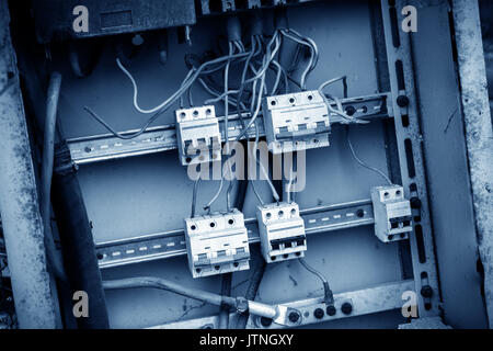 Save electricity sign on old electrical power wiring box in abandoned hospital - Stock Photo