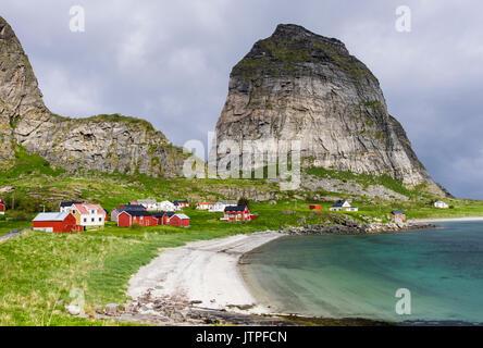 Sanna an old former fishing village houses below Trænstaven mountains in summer on Sanna island, Træna, Nordland - Stock Photo