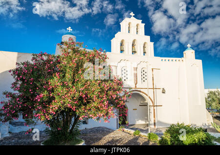 Pyrgos, Santorini island, Greece. Cycladic traditional village with blue domes of churches and white houses. - Stock Photo