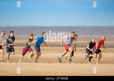 Southport, Merseyside, 10th August 2017. UK Weather.   A group of athletes on beautiful sunny day over the north - Stock Photo