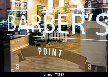 Barber's Point, a new SoHo shop in Lower Manhattan, opened in the summer of 2017 to cut men's hair and trim beards - Stock Photo