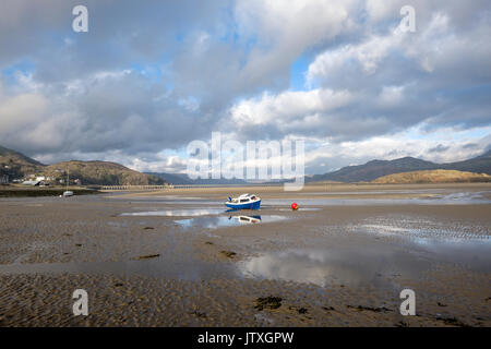 Mawddach estuary at low tide showing the Barmouth Bridge/Viaduct and distant hills of Snowdonia. - Stock Photo