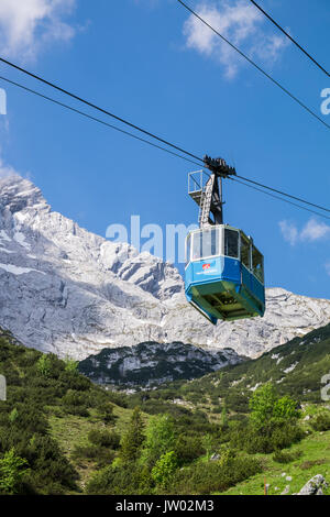 Hochalmbahn cable car cabin coming down the mountain, Hochalm, Kreuzeck, Zugspitzland, Bavaria, Germany - Stock Photo