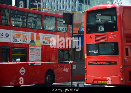 London, UK. 11th August, 2017. scene of accident buses and pedestrian in Nine Elms Lane at Vauxhall cross one day - Stock Photo
