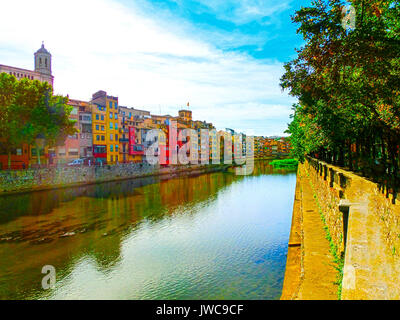 Colorful yellow and orange houses in Girona, Catalonia, Spain. - Stock Photo