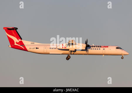 QantasLink de Havilland Canada DHC-8-402Q (Dash 8 Q400) VH-LQF on approach to land at Melbourne International Airport. - Stock Photo