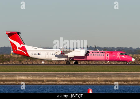 QantasLink (Qantas) deHavilland DHC-8 (Dash 8) twin engined regional airliner aircraft at Sydney Airport. - Stock Photo