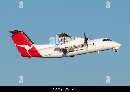 QantasLink (Qantas) deHavilland DHC-8 (Dash 8) twin engined regional airliner aircraft departing Sydney Airport. - Stock Photo