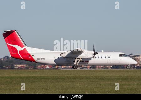 QantasLink deHavilland DHC-8 (Dash 8) twin engined regional airliner at Sydney Airport. - Stock Photo