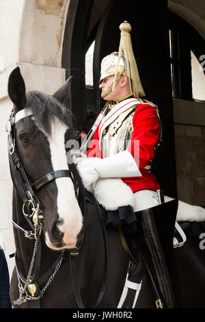 Horse guard sentry outside The Household Cavalry Museum, Horse Guards Parade, Whitehall, London, England, UK. - Stock Photo
